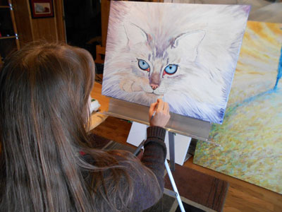 Anastasia Nelson painting a commissioned work